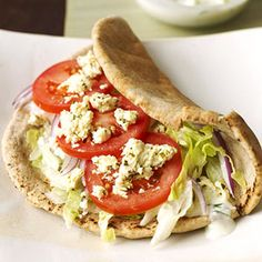 VEGGIE GYRO - Here's a quick and easy vegetarian version of the popular Greek sandwich. Slices of lettuce, onion, tomato and cheese are flavored with the traditional flavors of cucumber, garlic, and dill.