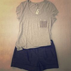 "Express Shirt Light gray shirt with embellished pocket. Brand New , with tags. Never worn. Make an offer using the ""offer"" button . Express Tops Tees - Short Sleeve"