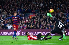 Neymar of FC Barcelona scores his team's second goal past Eneko Boveda (C) and Iago Herrerin of Athletic Club the La Liga match between FC Barcelona and Athletic Club de Bilbao at Camp Nou on January 17, 2016 in Barcelona