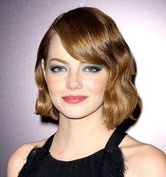 Emma Stone modeled a '20s-inspired beauty look, complete with a green smoky eye and finger waves, at the Magic in the Moonlight premiere in Paris on Sept. 11.