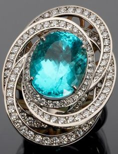 11.55 ct. Paraiba tourmaline, diamond, rose gold, and platinum ring designed by award-winning jewelry designer Judy Evans. #Paraiba #ParaibaTourmaline