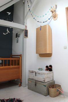 attic nursery | vintage storage crates | blue wall
