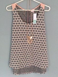 Adorable summer top. Love the design that makes it different from regular polka dots. Warm gray color, perfect for spring or even fall with a cardigan.