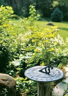 A Gardener's Tale FOCAL POINT:   Marney tucks fun focal points-such as sundials, urns, and metal sunflowers- throughout her garden. by silvia.mjf