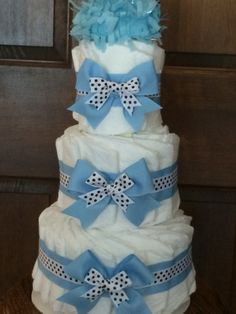 Blue Bow Diaper Cake Boy baby shower centerpiece/unique baby gift - http://www.babyshower-decorations.com/blue-bow-diaper-cake-boy-baby-shower-centerpieceunique-baby-gift.html