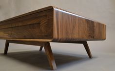 This was commissioned to match the look of the Lunar console table but to use the solid timber finger jointing technique rather than the wrap around veneer construction. It features two drawers on one side and an open shelf on the other to create useful storage. The leg design is taken from the Cathcart unit…
