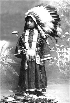 Portrait of Julie High Eagle, a Dakota Sioux girl.  Photo between 1880 and 1910.