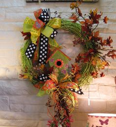 Whimsical birdhouse fall wreath with bright color fall leaves,  funky ribbons and curly raffia.