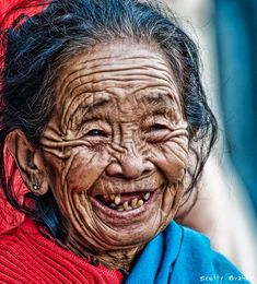 "'A Face and Smile To Remember'. Image and Caption © Scotty Graham. ""I was walking down a street in Kathmandu, and I saw this lady just laughing like there was no tomorrow while sitting on a wood bench...I have no idea what she was laughing about, but she loved to have her photo taken...which is actually unusual in Nepal as most older people do not like to have their photo taken. What a face....and what a smile!!"""
