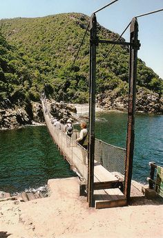 Storms River Bridge (at the mouth of the river) - Tsitsikamma Park, South Africa;  a 253 feet long footbridge built in 1969;  photo by bridgink, via Flickr
