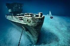From the cold waters of Scotland to the Great Barrier Reef lie the wrecks of once mighty warships.