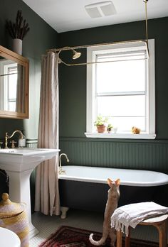 The Marion House book Here is the makeover of my Victorian bathroom with clawfoot tub. Walls painted in Benjamin Moore Backwoods green and Raccoon Fur tub. Ventilation fan by Broan. Clawfoot Tub Bathroom, Wainscoting Bathroom, Bath Tub, Bathroom Cabinets, Modern Master Bathroom, Small Bathroom, Rental Bathroom, Master Baths, Master Bathrooms