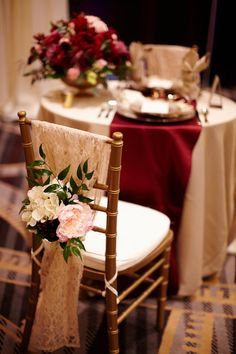 Gold Chiavari Chairs, Cherry Satin Linens by Southern Events. Perfect upscale wedding decor.