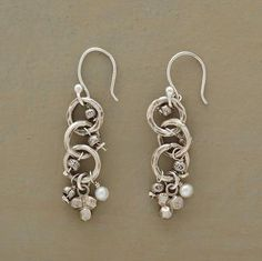 """Hammered sterling silver hoops swing and sway with tiny silver baubles and twin cultured pearls. Handcrafted with silver earwires. Approx. 1-1/4""""L."""