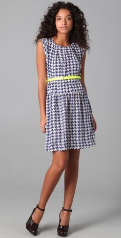 Love this color combo. Blue dress. Neon yellow belt.