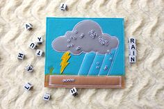 Rainy cloud letters felt quiet page is a high quality of work and material. Made with care and love. This page is intended for children 5-9 years of age. This page teaches your child fine motor skills by bringing the letters from the cloud to the ground and also helps children to