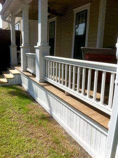 Columns but no rails, on low front porch, extend front porch about 2 - 3 ft beyond columns.