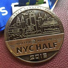 United Airlines NYC half marathon - New York City Half Marathon 2016 medal - 2016 bling photos - half marathon medal photos taken by Fifty States Half Marathon Club members www.50stateshalfmarathonclub.com