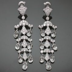 CARTIER Magnificent Diamond Platinum Chandelier Earrings. Spectacular red carpet elegance from the Cartier High Jewelry Collection. These exquisite rare earrings are made in 950 platinum and feature 14 natural briollete-cut diamond drops of an estimated 11 to 12 carat and brilliant-cut round F-G VVS1-VVS2 diamonds of an estimated 2.50 carats. Circa 2011.