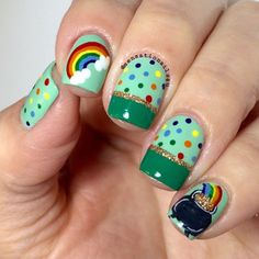 St Patricks Day Nails No. 3  Good evening loves. I did three different St Pattys Day designs. This is my last one for this year. Which one is your favorite? @sally_hansen Jade Jump @sinfulcolorsprofessional Garden Party and @chinaglazeofficial I herd That. Color details pot and rainbow painted with