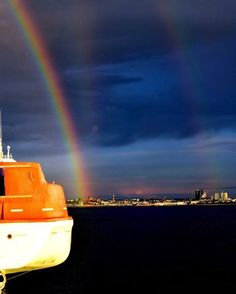 """""""Multiple rainbows as we approached the coast of Tallinn, Estonia, via ferry from Helsinki, Finland a few weeks ago, while the sun was setting behind us. Rain was blowing into my camera but I managed a few shots."""" - by Vinod Kutty #tallinn #estonia www.tallinn.com Helsinki, Rainbows, Finland, Northern Lights, This Is Us, Shots, Coast, Sun, Travel"""