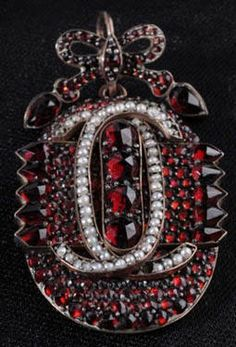 "Garnet locket/pendant has photo on back.  Seed pearls and bohemian garnets set in rose gold ~ 1 3/4"" long"