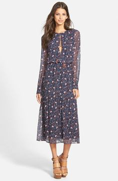 Free shipping and returns on Wayf Keyhole Midi Dress at Nordstrom.com. Tassel-trimmed ties dangle from the keyhole neckline of a vintage-inspired dress framed with airy, semi-sheer sleeves. A gently gathered waist defines the relaxed silhouette of this laid-back style finished with a ruffled hem.