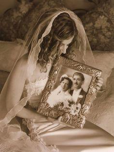 Bride holding parents wedding day photo.. Great Idea...