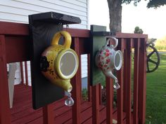 Teapot birdhouse. Bracket on the back let's you hang it on a deck railing.