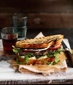 Garlicky Portobello Sandwich// 1 large portobello mushroom (stem removed), thickly sliced on an angle 1 garlic, peeled and finely chopped 1 tbsp finely chopped flat-leaf parsley 1 tbsp olive oil 4 slices sourdough bread 3 tbsp mayonnaise Small handful rocket leaves 1 ripe tomato, sliced