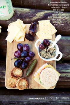 Personalized cheese plates on top of logs laid side by side