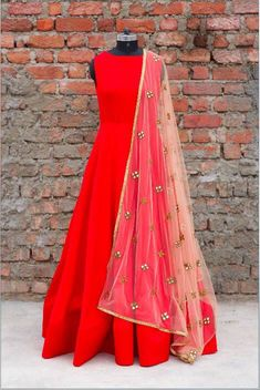 Striking floor length Anarkali teamed with lace duppata