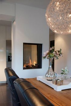 23 Two Sided Fireplace Designs in the lounge Two sided fireplace are becoming increasingly popular in new and renovated homes today. Two Sided Fireplace, Home Fireplace, Modern Fireplace, Fireplace Design, Piece A Vivre, Elegant Homes, Modern House Design, Home And Living, Living Spaces