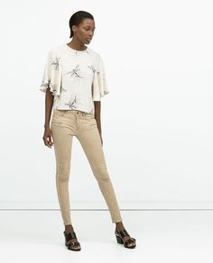 Garment Interpretation 5: These are beige trousers that are perfect for both Spring and Summer wear.  They fit very comfortably because they are made with cotton and 3% elastane.