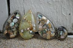 [I could do this with some of the shells from vacation!] Resin Pendants!
