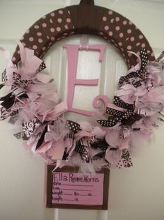 new baby ribbon wreath in pinks and browns with birth announcement on canvas for hospital door