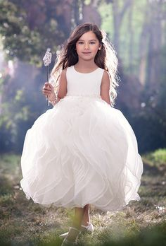 Brides: Disney Fairy Tale Weddings by Alfred Angelo. Whimsical sleeveless ball gown in with an organza bodice, beaded waistband, and voluminous ruffled organza skirt.