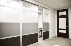 Glide is an overhead sliding room divider system designed to separate spaces and provide elegant, functional openings. Take your space to the next level. Door Dividers, Sliding Room Dividers, Room Divider Doors, Diy Room Divider, Sliding Screen Doors, Sliding Glass Door, Staircase Storage, Divider Design, Workspace Design