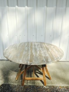 Reclaimed oak barn wood round table with white lime wash top and natural finish base.