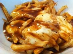 DJ BBQ has an awesometacular twist on the classic Canadian Poutine recipe. Twice cooked fries beautifully crisp and fluffy are topped with soft and gooey moz. Poutine Gravy Recipe, Gravy Fries, Canadian Poutine, Fried Butter, Delicious Food, Tasty, State Fair Food, Frozen Potatoes, Cook Cook