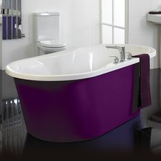 purple tub! fun way to add color to bathrooms in unexpected ways.