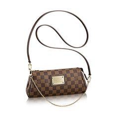 Entdecken Sie Eva Diese Tasche aus weichem Damier Canvas mit dem beeindruckenden Louis Vuitton Inventeur Schild kann als Pochette, über der Schulter oder diagonal am Körper getragen werden.