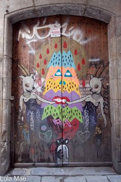 Barcelona Street Art  on a Door #Doors  I like the idea of painting something on wood, not necessarily this design. :)