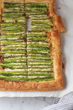 """APPETIZER: ASPARAGUS GRUYERE TART – Is there anything that puff pastry can't make? When topped with melted gruyere and roasted asparagus, puff pastry transforms into the ultimate """"pizza"""" app. Click through for the rest of the gallery and for more easter recipes."""