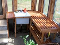 Utility sink in greenhouse solid and slotted potting bench area Greenhouse Interiors, Home Greenhouse, Small Greenhouse, Greenhouse Tables, Greenhouse Ideas, Greenhouse Shelves, Greenhouse Gardening, Greenhouse Kitchen, Greenhouse Wedding