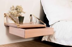 floating shelf with draw from joska and sons for around the t.v. provides storage and area for display.