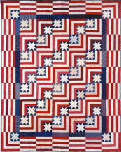 America the Beautiful designed by Will Bennett. The quilt and pattern are in Judy Martin's 2002 book, Piece 'n' Play Quilts.