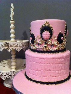 Beautiful pink, black, and gold cake.