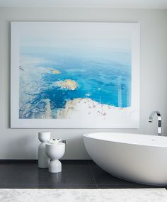 The addition of statement artwork in the forgotten area of the bathroom, makes you feel like your on vacation while taking a soak in the tub! Bathroom Plants, Bathroom Faucets, Bathroom Tiling, Bathroom Renovations, Bathroom Lighting, Photo Grand Format, Bathroom Artwork, Master Bathroom, Bathroom Furniture