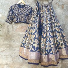 Buy blue banarasi silk with sprightly lace work & embroidery work designer lehenga choli online.This set is features a dark blue blouse in silk fully embellished with crystal, embroidery and sequins work.It has matching blue lehenga in banarasi silk w Banarasi Lehenga, Patiala Salwar, Anarkali, Blue Lehenga, Brocade Lehenga, Lengha Choli, Sabyasachi, Mode Bollywood, Bollywood Fashion